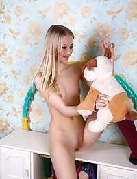 Light-haired chick in playroom